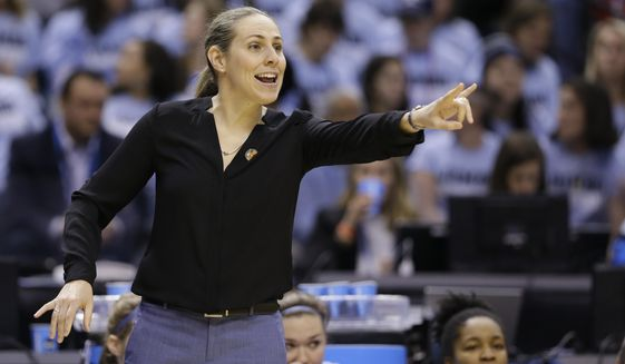 FILE - In this April 4, 2016, file photo, Tufts head coach Carla Berube directs her team as they play Thomas More during the first half of the championship game at the women's NCAA Division III basketball tournament in Indianapolis. Princeton coach Berube knew she inherited a really good team when she took over the Tigers this year after Courtney Banghart left to coach North Carolina.(AP Photo/Michael Conroy, File)