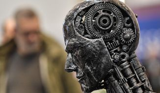 In this Nov. 29, 2019, file photo, a metal head made of motor parts symbolizes artificial intelligence, or AI, at the Essen Motor Show for tuning and motorsports in Essen, Germany. The Trump administration is proposing new rules guiding how the U.S. government regulates the use of artificial intelligence in medicine, transportation and other industries. The White House unveiled the proposals Tuesday, Jan. 7, and said they're meant to promote private sector applications of AI that are safe and fair. (AP Photo/Martin Meissner, File)