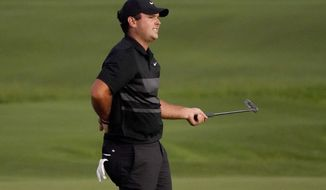 Patrick Reed reacts to missing his putt on the third playoff hole on the 18th green during final round of the Tournament of Champions golf event, Sunday, Jan. 5, 2020, at Kapalua Plantation Course in Kapalua, Hawaii. (AP Photo/Matt York)