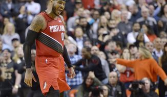 Portland Trail Blazers forward Carmelo Anthony (00) reacts after sinking a go-ahead basket against the Toronto Raptors during the second half of an NBA basketball game Tuesday, Jan. 7, 2020, in Toronto. (Nathan Denette/The Canadian Press via AP)