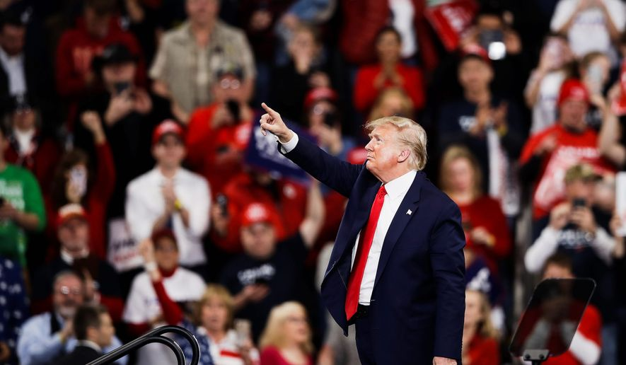 It's campaign rally season. President Trump shares a moment with the crowd during a recent campaign rally in Hershey, Pennsylvania. (Associated Press)  ** FILE **