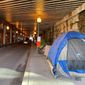 D.C. officials plan to permanently remove the encampment of homeless people under the K Street NE underpass in the NoMa neighborhood, beginning Jan. 16. Officials say the tents create a potential danger by forcing pedestrians to walk in the street. (Sophie Kaplan/The Washington Times)
