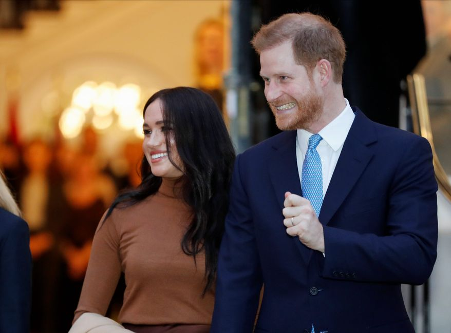 Britain's Prince Harry and Meghan, Duchess of Sussex leave after visiting Canada House in London after their recent stay in Canada. (AP Photo/Frank Augstein, FILE)