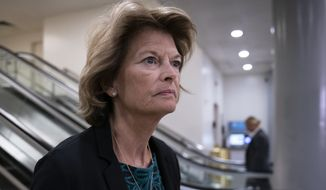 Sen. Lisa Murkowski, R-Alaska, heads to a briefing by Secretary of State Mike Pompeo, Defense Secretary Mark Esper, and other national security officials on the details of the threat that prompted the U.S. to kill Iranian Gen. Qassem Soleimani in Iraq, Wednesday, Jan. 8, 2020 on Capitol Hill in Washington. (AP Photo/J. Scott Applewhite)