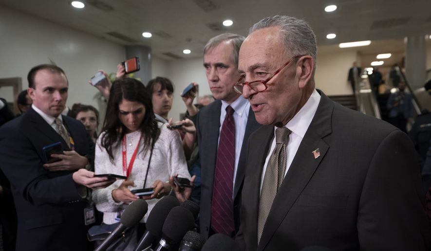 Senate Minority Leader Chuck Schumer, D-N.Y., joined at left by Sen. Jeff Merkley, D-Ore., a member of the Foreign Relations Committee, responds to reporters following a briefing by Secretary of State Mike Pompeo, Defense Secretary Mark Esper, and other national security officials on the details of the threat that prompted the U.S. to kill Iranian Gen. Qassem Soleimani in Iraq, Wednesday, Jan. 8, 2020 on Capitol Hill in Washington. (AP Photo/J. Scott Applewhite)