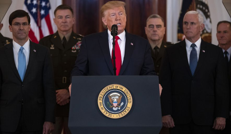President Donald Trump addresses the nation from the White House on the ballistic missile strike that Iran launched against Iraqi air bases housing U.S. troops, Wednesday, Jan. 8, 2020, in Washington, as Secretary of Defense Mark Esper, Chairman of the Joint Chiefs of Staff Gen. Mark Milley, and Vice President Mike Pence, and others look on. (AP Photo/ Evan Vucci)