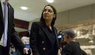 Rep. Alexandria Ocasio-Cortez, D-N.Y., arrives for a briefing on last week's targeted killing of Iran's senior military commander Gen. Qassem Soleimani on Capitol Hill, in Washington, Wednesday, Jan. 8, 2020. (AP Photo/Jose Luis Magana)