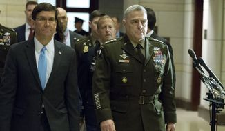 Secretary of Defense Mark Esper, accompanied by Joint Chiefs of Staff Chairman Gen. Mark Milley arrive to conduct briefings for members of Congress on last week's targeted killing of Iran's senior military commander Gen. Qassem Soleimani on Capitol Hill, in Washington, Wednesday, Jan. 8, 2020. (AP Photo/Jose Luis Magana)
