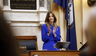 Virginia House of Delegates, Speaker Eileen Filler-Corn, D-Fairfax, applauds as she delivers remarks during opening ceremonies of the 2020 Virginia General Assembly at the Capitol in Richmond, Va., Wednesday, Jan. 8, 2020. Filler-Corn is the first woman to hold the position. (AP Photo/Steve Helber)