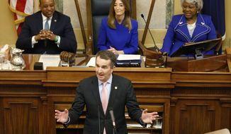 Virginia Gov. Ralph Northam, bottom, delivers his State of the Commonwealth address as House Speaker Eileen Filler-Corn, D-Farifax, top center, Lt. Gov. Justin Fairfax, top left, and Senate President Pro Tempore Louise Lucas, D-Portsmouth, right, listen during a joint session of the Virginia Assembly at the Virginia state Capitol in Richmond, Va., Wednesday, Jan. 8, 2020. (AP Photo/Steve Helber)