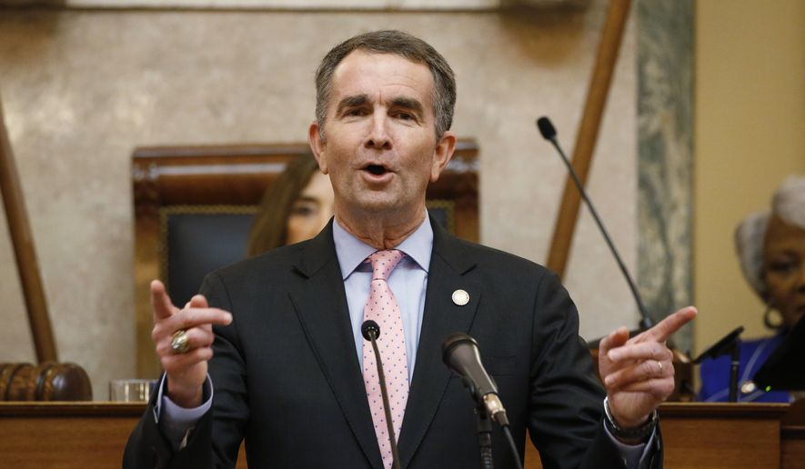Virginia Gov. Ralph Northam gestures as he delivers his State of the Commonwealth address before a joint session of the Assembly at the state Capitol in Richmond, Va., Wednesday, Jan. 8, 2020. (AP Photo/Steve Helber) ** FILE **