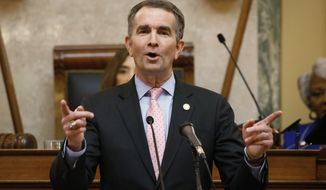Virginia Gov. Ralph Northam gestures as he delivers his State of the Commonwealth address before a joint session of the Assembly at the state Capitol in Richmond, Va., Wednesday, Jan. 8, 2020. (AP Photo/Steve Helber)