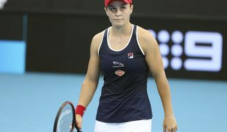 Ashleigh Barty of Australia reacts after missing a shot during her match against Jennifer Brady of the United States at the Brisbane International tennis tournament in Brisbane, Australia, Thursday, Jan. 9, 2020. (AP Photo/Tertius Pickard)