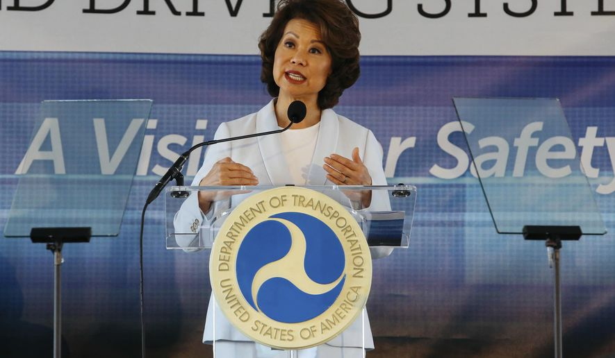 """In this Sept. 12, 2017 file photo,  U.S. Transportation Secretary Elaine Chao announces new voluntary safety guidelines for self-driving cars during a visit to an autonomous vehicle testing facility at the University of Michigan, in Ann Arbor, Mich.  The Trump administration announced its most recent round of guidelines for autonomous vehicle makers, continuing to rely on the industry to police itself despite calls for specific regulations.  Chao announced the proposed guidelines in a speech Wednesday, Jan. 8, 2020 at the CES gadget show in Las Vegas, saying in prepared remarks that """"AV 4.0"""" will ensure U.S. leadership in developing new technologies.(Hunter Dyke/The Ann Arbor News via AP, File)  **FILE**"""
