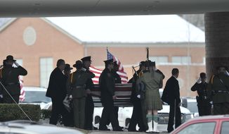 FILE - In this Dec. 22, 2010, file photo, law enforcement officers carry the casket of Border Patrol officer and former U.S. Marine Brian Terry out of Greater Grace Temple after his funeral service in Detroit. The trigger man in the 2010 shooting death of Terry in Arizona is scheduled to be sentenced in Tucson. Heraclio Osorio-Arellanes is being sentenced on Wednesday, Jan. 8, 2020, for his first-degree murder conviction. (John T. Greilick/Detroit News via AP, File)