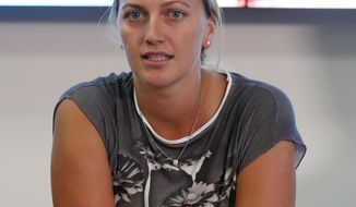 FILE - In this Friday, Dec. 23, 2016 file photo, Czech Republic's Petra Kvitova gives a statement to the media in Prague, Czech Republic. The two-time Wimbledon champion was injured Tuesday Dec. 20, 2016 when a knife-wielding intruder attacked her at her home in the town of Prostejov. On Monday Jan. 8, 2020, an appeals court in the Czech Republic upheld a lower court conviction of a man of knifing Kvitova in her home and increased his sentence from eight to 11 years in prison. (AP Photo/Petr David Josek, File)
