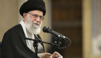 """In this picture released by the official website of the office of the Iranian supreme leader, Supreme Leader Ayatollah Ali Khamenei speaks to a group of residents of the city of Qom, in Tehran, Iran, Wednesday, Jan. 8, 2020. Ayatollah Khamenei said """"we slapped them (Americans) on the face last night"""" with a missile strike """"but military action is not enough."""" He spoke hours after the strike at military bases in Iraq used by U.S. forces. The strike was in retaliation for the U.S. killing of Iran's top military commander in Baghdad. (Office of the Iranian Supreme Leader via AP)"""
