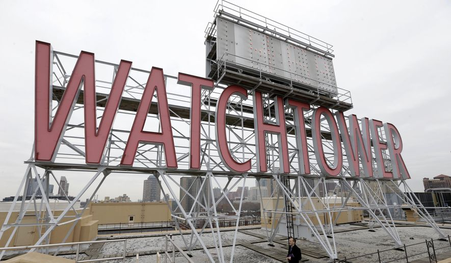 In this Dec. 9, 2015, file photo, the iconic Watchtower sign is seen on the roof of 25-30 Columbia Heights, then world headquarters of the Jehovah's Witnesses, in the Brooklyn borough of New York.  (AP Photo/Seth Wenig, File)  **FILE**