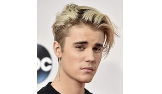 """FILE - This Nov. 22, 2015 file photo shows Justin Bieber at the American Music Awards in Los Angeles. Bieber says that he has been battling Lyme disease. In an Instagram post on Wednesday, Jan. 8, 2020, the pop star wrote that """"it's been a rough couple years but (I'm) getting the right treatment that will help treat this so far incurable disease and I will be back and better than ever."""" Lyme disease is transmitted by Ixodes ticks, also known as deer ticks. Lyme can cause flu-like conditions, neurological problems, joint paint and other symptoms. (AP Photo by Jordan Strauss/Invision/AP)"""