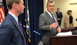 Republican state Sen. Robby Mills, right, discusses his bill on Wednesday, Jan. 8, 2020, in Frankfort, Ky., that would require Kentuckians to present photo identification in order to vote. The bill won a quick endorsement from Secretary of State Michael Adams, left,, a Republican who took office this week (AP Photo/Bruce Schreiner)
