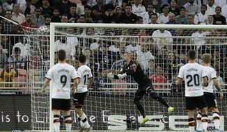 Valencia's goalkeeper Jasper Cillessen, center, fails to stop the opening goal from Real Madrid's Toni Kroos during the Spanish Super Cup semifinal soccer match between Real Madrid and Valencia at King Abdullah stadium in Jiddah, Saudi Arabia, Wednesday, Jan. 8, 2020. (AP Photo/Hassan Ammar)