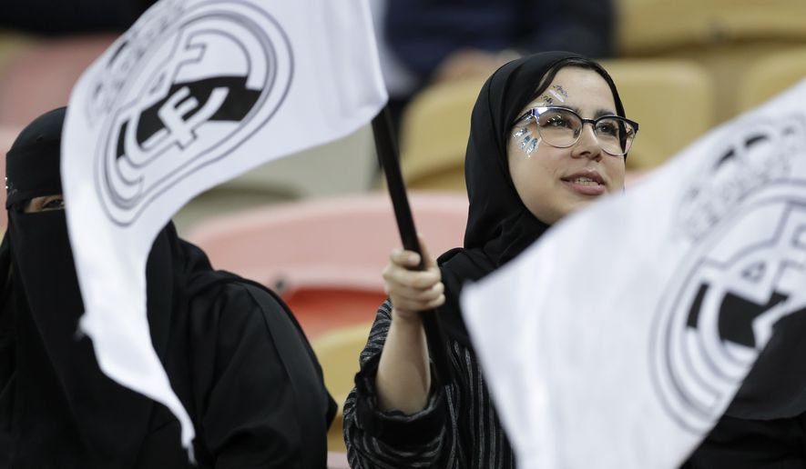 Fans on the stands, waiving Real Madrid flags, wait for the start of the Spanish Super Cup semifinal soccer match between Real Madrid and Valencia at King Abdullah stadium in Jiddah, Saudi Arabia, Wednesday, Jan. 8, 2020. (AP Photo/Hassan Ammar)