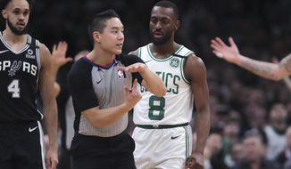 Boston Celtics guard Kemba Walker (8) watches as referee Evan Scott charges him with a technical foul during the third quarter of an NBA basketball game Wednesday, Jan. 8, 2020 in Boston. (AP Photo/Charles Krupa)