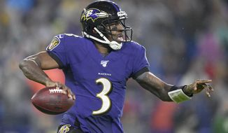 Baltimore Ravens quarterback Robert Griffin III looks to pass against the Pittsburgh Steelers during the first half of an NFL football game, Sunday, Dec. 29, 2019, in Baltimore. (AP Photo/Nick Wass) ** FILE **
