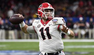 Georgia quarterback Jake Fromm (11) passes in the first half of the Sugar Bowl NCAA college football game against Baylor in New Orleans, Wednesday, Jan. 1, 2020. (AP Photo/Bill Feig) ** FILE **
