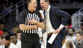 Cincinnati coach John Brannen argues with an official during the first half of the team's NCAA college basketball game against Tulsa on Wednesday, Jan. 8, 2020, in Cincinnati. (Kareem Elagazzar/The Cincinnati Enquirer via AP)