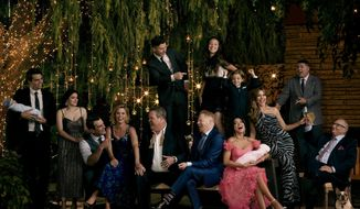 """This image released by ABC shows the cast of the ABC sitcom """"Modern Family,"""" from left, Reid Ewing, Ariel Winter, Ty Burrell Julie Bowen, Eric Stonestreet, Nolan Gould, standing left center, Jesse Tyler Ferguson, Aubrey Anderson-Emmons, standing center right, Jeremy Maguire, Sarah Hyland, seated holding baby, Sofía Vergara, Rico Rodriguez and Ed O'Neill. The comedy will air its series finale after 11 seasons on April 8, the network announced on Wednesday. (Jill Greenberg/ABC via AP)"""