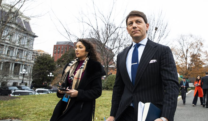 White House deputy press secretary Hogan Gidley walks back to the West Wing of the White House after speaking to reporters, Friday, Dec. 6, 2019, in Washington. (AP Photo/Manuel Balce Ceneta)