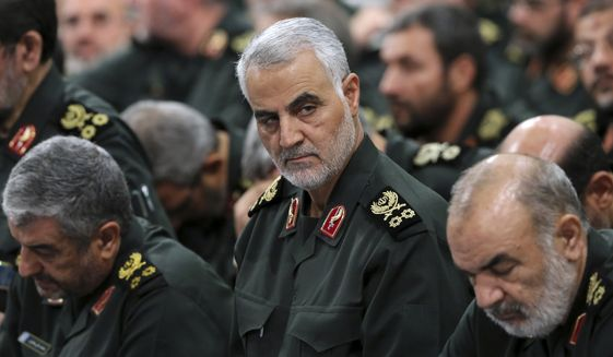 In this Sept. 18, 2016, file photo provided by an official website of the office of the Iranian supreme leader, Revolutionary Guard Gen. Qassem Soleimani, center, attends a meeting in Tehran, Iran. Soleimani, the head of Irans elite Quds Force, was killed in an airstrike at Baghdad's international airport, in January 2020. A UN report released in July 2020, says the U.S. violated international law in the targeted killing. (Office of the Iranian Supreme Leader via AP, File)  **FILE**