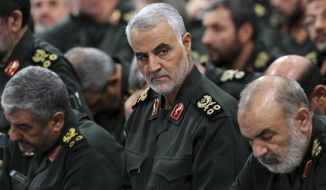 In this Sept. 18, 2016, file photo provided by an official website of the office of the Iranian supreme leader, Revolutionary Guard Gen. Qassem Soleimani, center, attends a meeting in Tehran, Iran. Iraqi TV and three Iraqi officials said Friday, Jan. 3, 2020, that Soleimani, the head of Irans elite Quds Force, has been killed in an airstrike at Baghdads international airport. (Office of the Iranian Supreme Leader via AP, File)