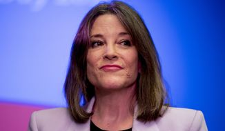 Democratic presidential candidate Marianne Williamson pauses while speaking at a the Faith, Politics and the Common Good Forum at Franklin Jr. High School, Thursday, Jan. 9, 2020, in Des Moines, Iowa. (AP Photo/Andrew Harnik)