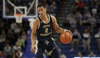 George Washington's Armel Potter brings the ball down the court during the first half of an NCAA college basketball game against Saint Louis Wednesday, Jan. 8, 2020, in St. Louis. (AP Photo/Jeff Roberson) **FILE**