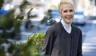 FILE - This June 23, 2019, file photo shows E. Jean Carroll in New York. President Donald Trump has lost a bid to block the advice columnist's lawsuit's over his remarks that she lied in accusing him of rape. In a decision Monday, Jan. 6, 2020, a Manhattan judge declined to order a hearing on Trump's request to dismiss Carroll's defamation suit and to put evidence-gathering on hold in the meantime. (AP Photo/Craig Ruttle, File)