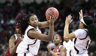 South Carolina forward Aliyah Boston (4) grabs a rebound against Arkansas during the second half of an NCAA college basketball game Thursday, Jan. 9, 2020, in Columbia, S.C. (AP Photo/Sean Rayford)