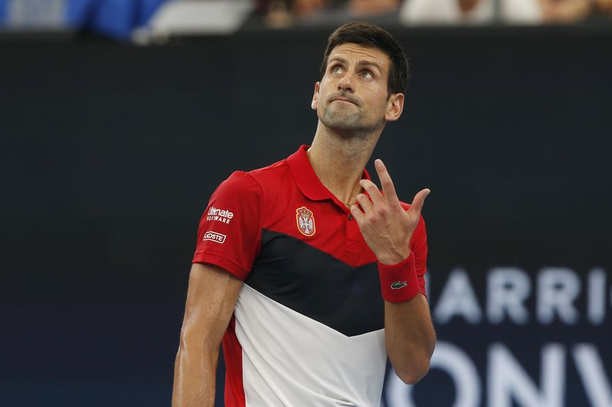 Novak Djokovic of Serbia reacts during their ATP Cup tennis match against Denis Shapovalov of Canada in Sydney, Friday, Jan. 10, 2020. (AP Photo/Steve Christo)