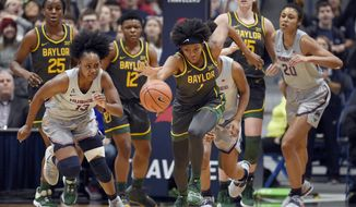 Baylor's NaLyssa Smith, center, grabs takes off with a rebound during the first half of the team's NCAA college basketball game against Connecticut, Thursday, Jan. 9, 2020, in Hartford, Conn. (AP Photo/Jessica Hill)