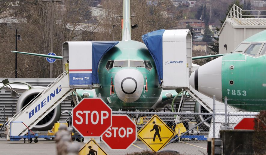 In this Monday, Dec. 16, 2019, file photo, Boeing 737 Max jets sit parked in Renton, Wash. Newly released Boeing documents show that company employees knew about problems with flight simulators for the now-grounded 737 Max jetliner and talked about misleading regulators. (AP Photo/Elaine Thompson, File)