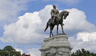 This June 27, 2017, file photo, shows the Confederate General Robert E. Lee statue that stands in the middle of a traffic circle on Monument Avenue in Richmond, Va. (AP Photo/Steve Helber)