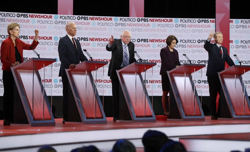 FILE - In this Dec. 19, 2019 file photo, Democratic presidential candidates from left, Sen. Elizabeth Warren, D-Mass., former Vice President Joe Biden, Sen. Bernie Sanders, I-Vt., Sen. Amy Klobuchar, D-Minn., and businessman Tom Steyer participate during a Democratic presidential primary debate in Los Angeles. (AP Photo/Chris Carlson)