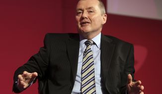 FILE - In this file photo dated Monday, June 2, 2014, Willie Walsh, chief executive officer for International Airlines Group, speaks during a panel discussion of the 70th International Air Transport Association (IATA) in Doha, Qatar.  International Airlines Group, the parent company of British Airways, said Thursday Jan. 9, 2020, that its longtime CEO Willie Walsh is stepping down. (AP Photo/Osama Faisal, FILE)