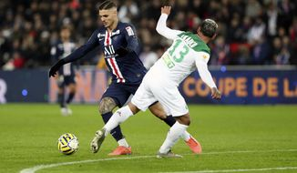 PSG's Mauro Icardi, left, vies for the ball with Saint Etienne's Miguel Trauco during the French League Cup quarter final soccer match between Paris Saint Germain and Saint Etienne at the Parc des Princes stadium in Paris, Wednesday, Jan. 8, 2020. (AP Photo/Thibault Camus)