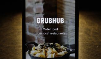 This Feb. 20, 2018, file photo shows the Grubhub app on an iPhone in Chicago.  (AP Photo/Charles Rex Arbogast, File) **FILE**