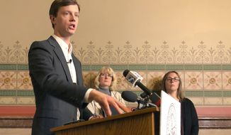Iowa Auditor Rob Sand explains results of an audit his agency conducted of the Iowa Medicaid Home Health Services program during a news conference at the Iowa Capitol, Thursday, Jan. 9, 2020. Standing behind him are Deputy Auditor Annette Campbell, left, and Senior Auditor Melissa Finestead. Sand criticized the Iowa Department of Human Services for providing data he claimed was so flawed he couldn't test it. (AP Photo/David Pitt)