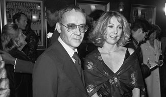 """In this Nov. 15, 1977, file photo, Buck Henry and Teri Garr appear at the opening of the movie """"Close Encounters of the Third Kind"""" in New York. Henry, the versatile writer, director and character actor who co-wrote and appeared in """"The Graduate'' has died in Los Angeles. He was 89. Henry's wife, Irene Ramp, told The Washington Post that his death was due to a heart attack. (AP Photo/Ira Schwarz, File)"""