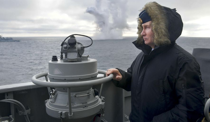 Russian President Vladimir Putin watches a navy exercise from the Marshal Ustinov missile cruiser in the Black Sea in , Crimea, Thursday, Jan. 9, 2020. The drills involved warships and aircraft that launched missiles at practice targets. (Alexei Druzhinin, Sputnik, Kremlin Pool Photo via AP)