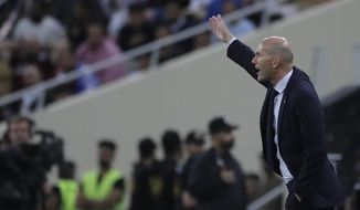 Real Madrid's head coach Zinedine Zidane instructs his players during the Spanish Super Cup semifinal soccer match between Real Madrid and Valencia at King Abdullah stadium in Jiddah, Saudi Arabia, Thursday, Jan. 9, 2020. (AP Photo/Amr Nabil)